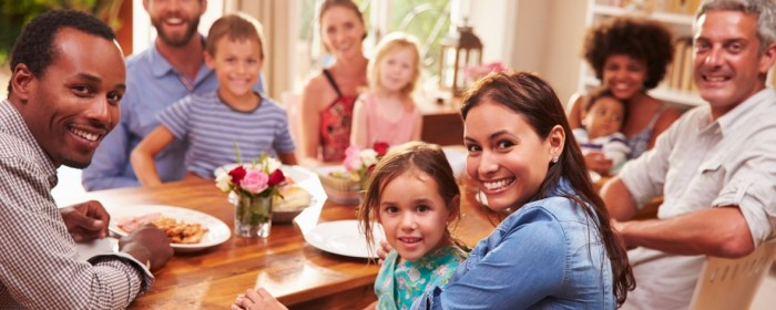 bigstock-Family-and-friends-sitting-at-95387342-1180x472